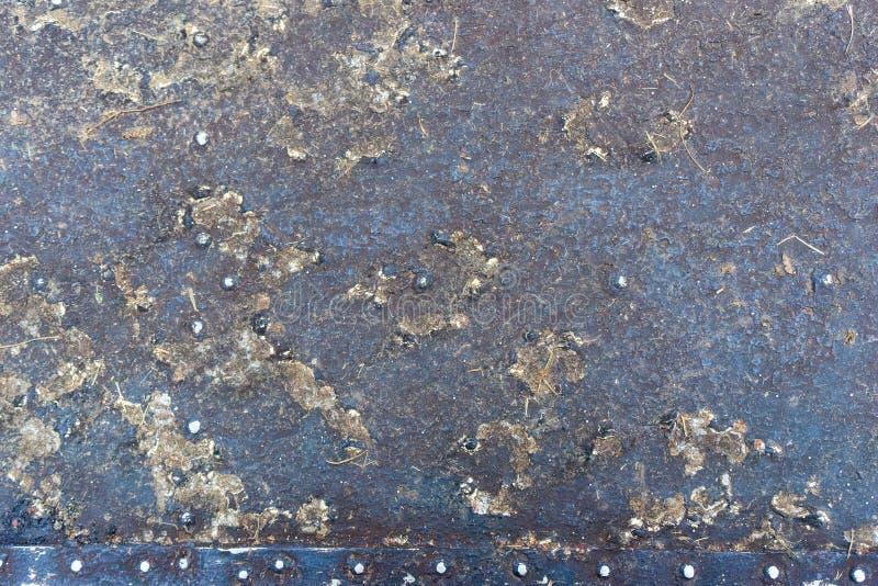 Korroderade rostig kulör metall för closeupen, abstrakt grunge stålbakgrund, den metalliska bakgrunden för retro tappning, järnyt fotografering för bildbyråer