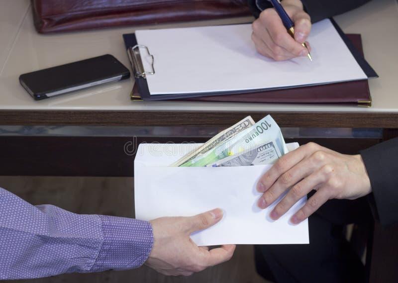 Korruption och bestickning royaltyfri bild