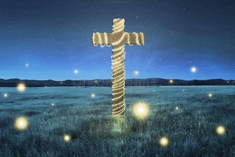 Korsa med garnering för julljus på fältet royaltyfria bilder