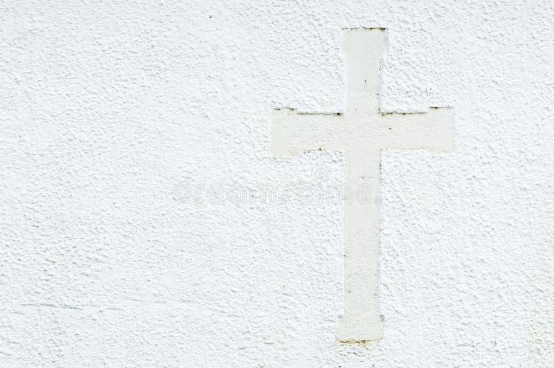 Korsa på väggen arkivfoton