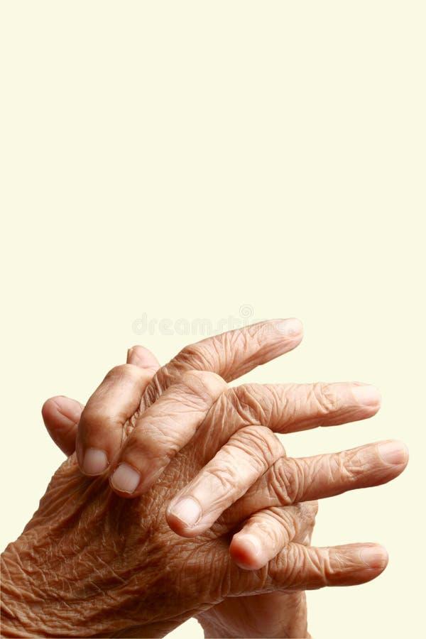 korsade fingrar arkivfoto