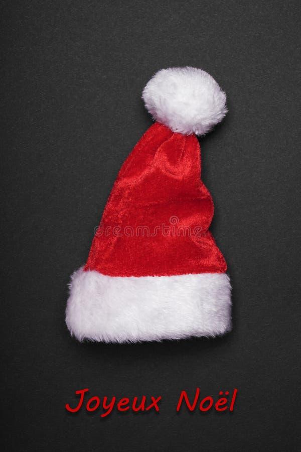 Kort för Joyeux Noel franskt julhälsning arkivfoto