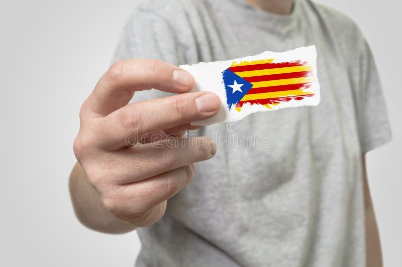 Kort med den Catalonia flaggan i hand royaltyfria foton
