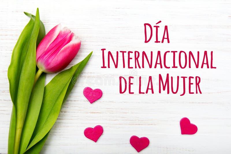 Kortet för dagen för kvinna` s med spanjor uttrycker `-DÃa Internationell de la Mujer `, arkivfoto