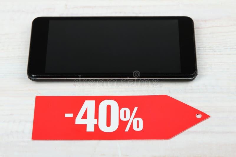 Korting van veertig percenten en een smartphone royalty-vrije stock foto's