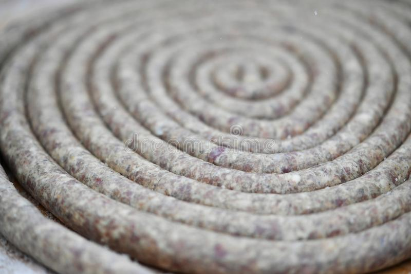 Korv i en spiral royaltyfria bilder