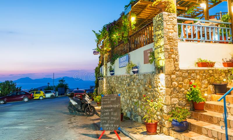 KOS, GREECE - JUNE 6, 2014: Tourists visit the city at night. Ko. S is a major destination in Greece royalty free stock photography