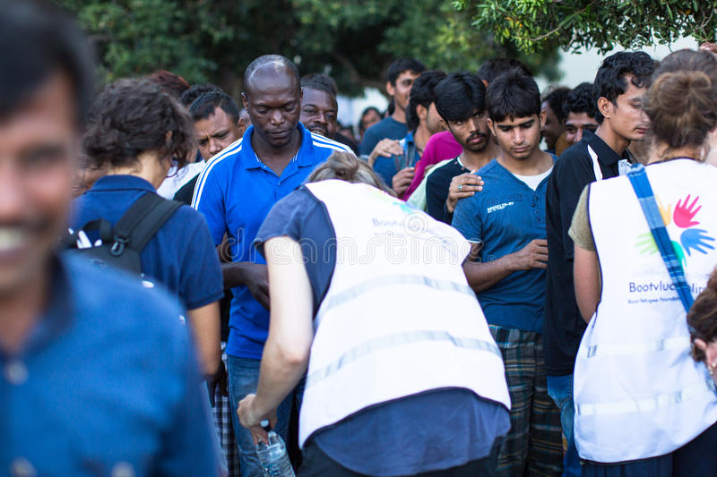 Kos island, Greece - European Refugee Crisis. KOS, GREECE - SEP 28, 2015: Refugees receive humanitarian assistance. More than half are migrants from Syria, but stock image