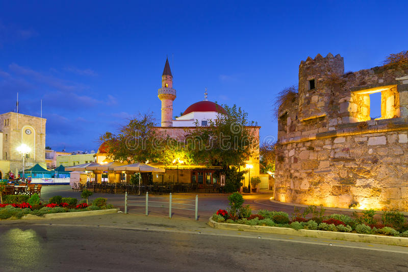Kos island. Mosque and coffee shops in the main square of the Kos town stock photo