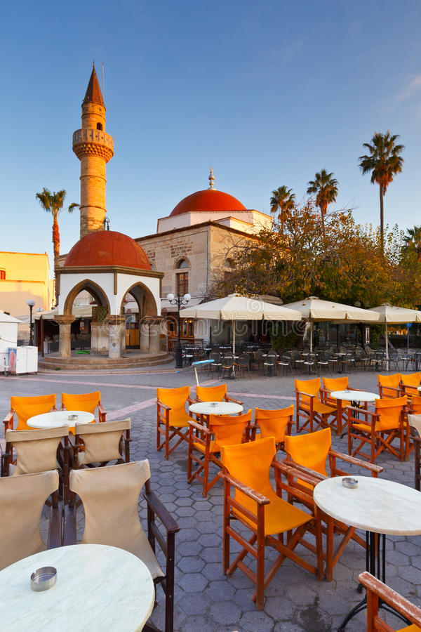 Kos island. Mosque and coffee shops in the main square of the Kos town stock images