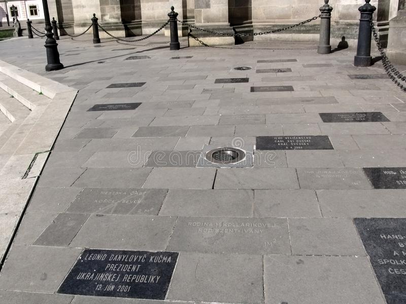 Square with engraved name stone slabs near the Temple of St. Elizabeth in Kosice stock photo