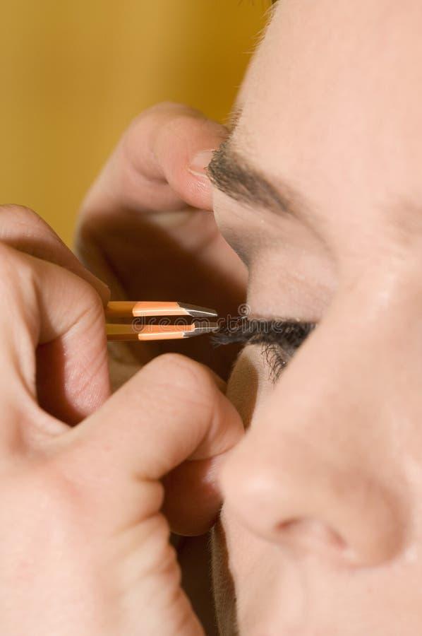 Kosmetik auf Wimpern stockfoto