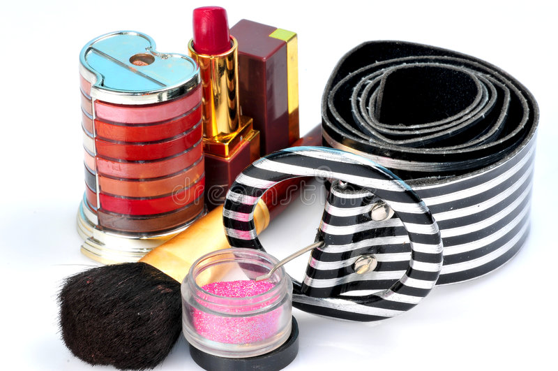 Kosmetik und Gurt lizenzfreie stockfotografie