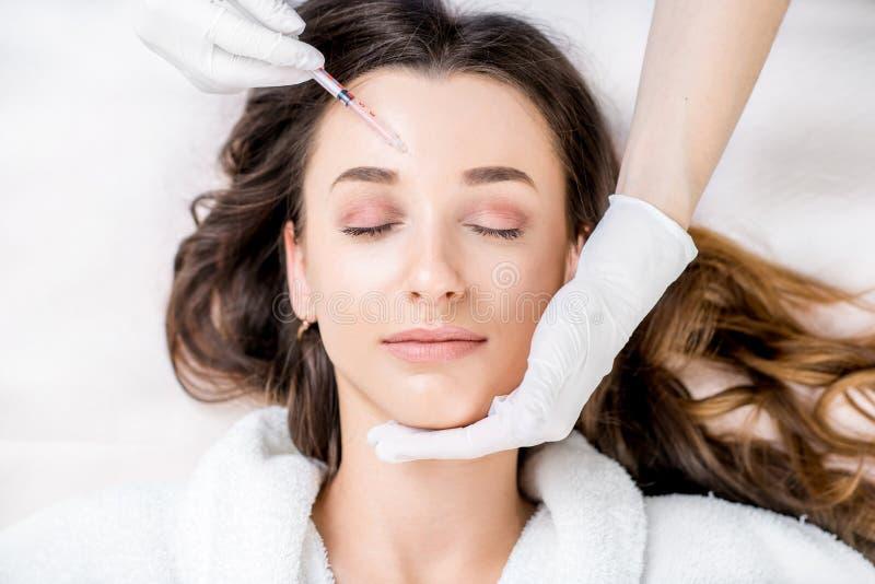 Kosmetische botox Einspritzung stockfoto