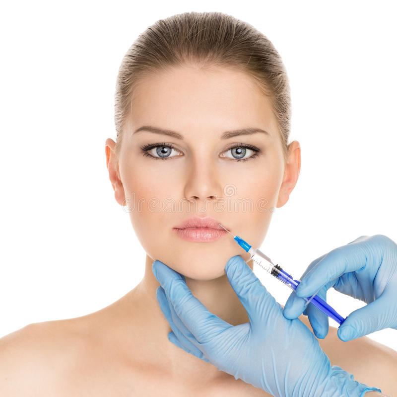 Kosmetische chirurgievrouw stock afbeelding