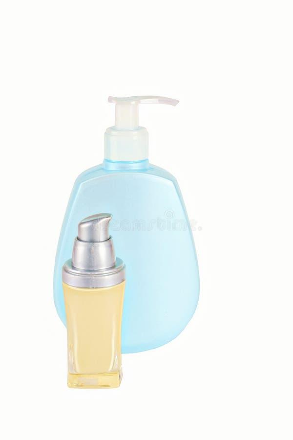Kosmetische die container met stichtingsroom op wit wordt geïsoleerd stock afbeeldingen