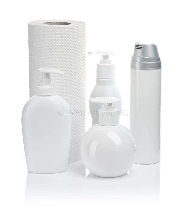 Kosmetische flessenkeukenrollen royalty-vrije stock afbeelding