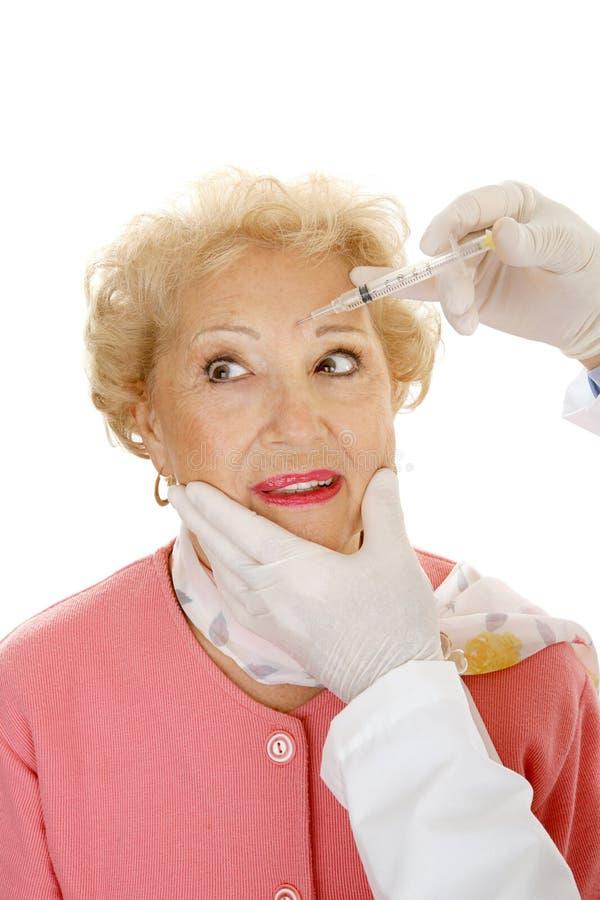 Kosmetische Injectie - Frown Lijnen stock afbeeldingen