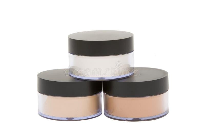 Kosmetische kruiken met poeder dat in wit wordt geïsoleerd royalty-vrije stock foto