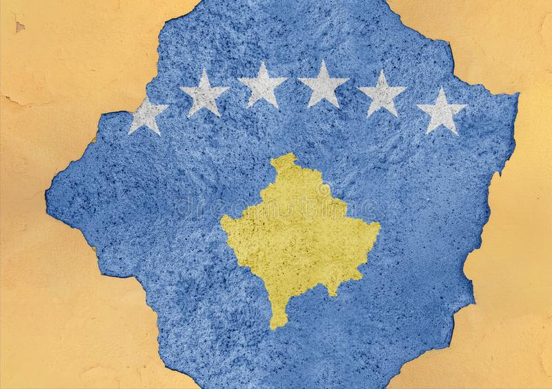 Kosovo state flag broken material facade structure in big concrete. Cracked hole stock image