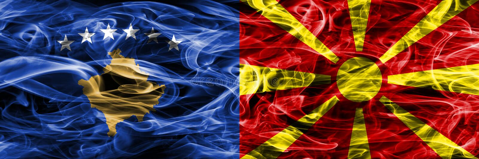 Kosovo vs Macedonia smoke flags placed side by side royalty free stock photo