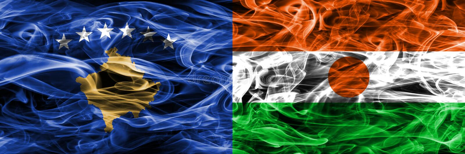 Kosovo vs Niger smoke flags placed side by side.  stock photo