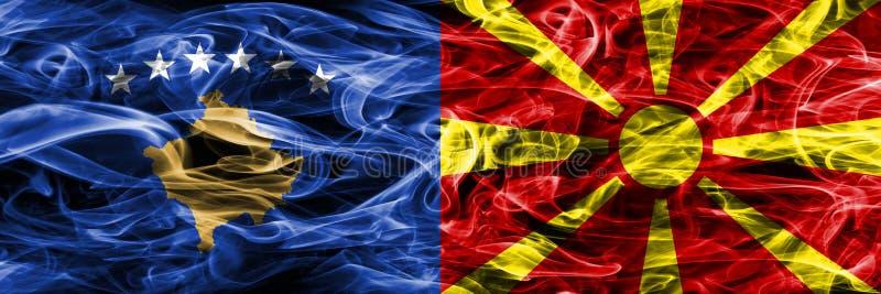Kosowo vs Macedonia dymu flaga umieszczająca strona strona - obok - zdjęcie royalty free