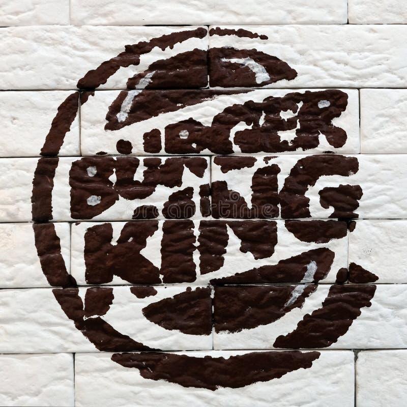 Kostanay, Kazakhstan, 11-25-2018, Burger King logo painted on a brick wall in a restaurant. Opening day. Popular fast food item. Kostanay, Kazakhstan, 11-25-2018 royalty free stock photo