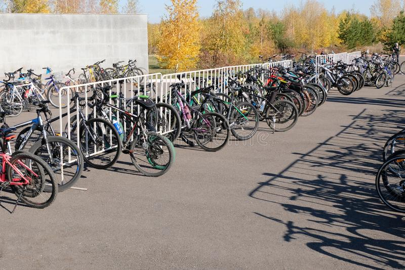 Kostanay, Kazakhstan, 2019-10-06. Bike ride. Parking bicycles of different brands in nature. Autumn, yellow leaves on the trees. royalty free stock images
