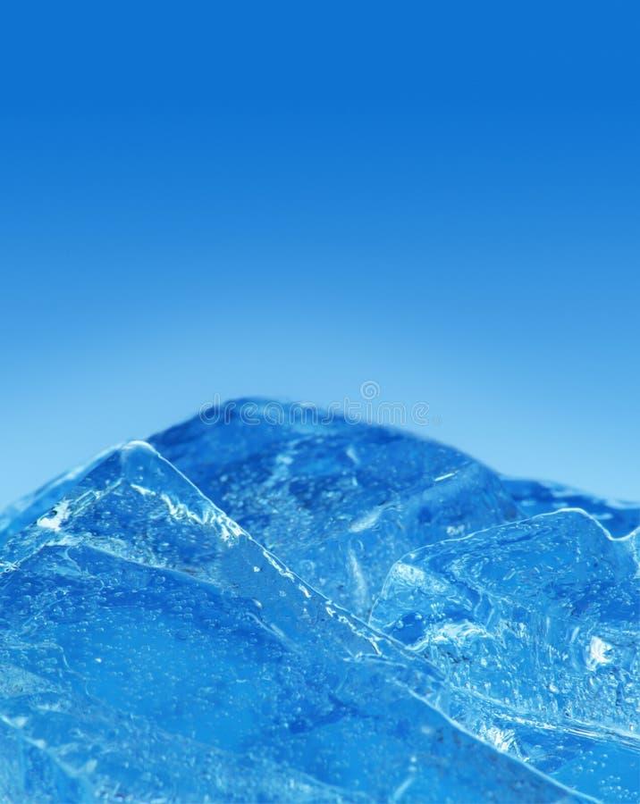 Kostki lodu na bławym tle, wyszczególniają makro- zdjęcie stock