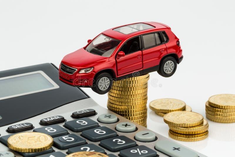 Kostnad av bilen med räknemaskinen arkivfoto