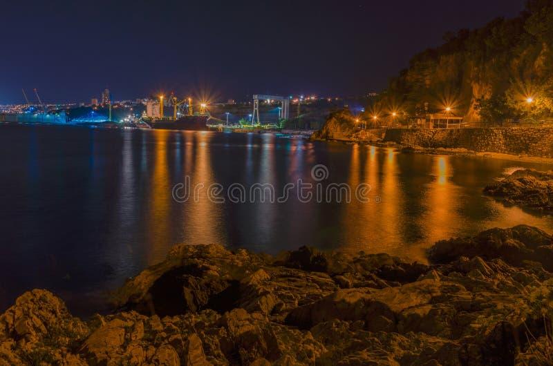 Kostrena w nocy z Rijeka na tle, Chorwacja fotografia royalty free