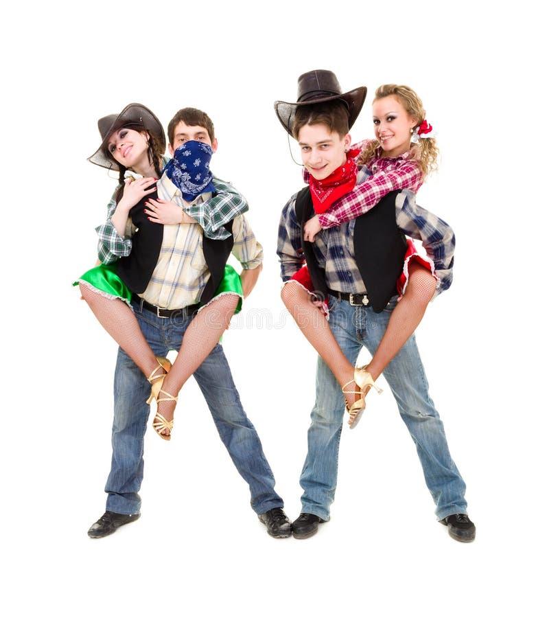Dräkter för cowboy för kabaretdansarelag iklädda arkivfoto
