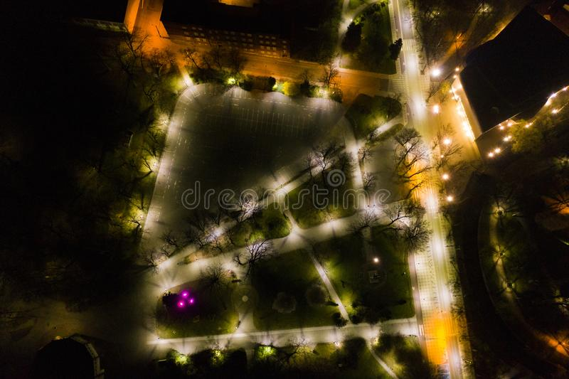 KOSZALIN, POLAND - 07 APRIL 2019 - Aerial view on Koszalin city at night with street lights, area of Jednosci street and city park stock image