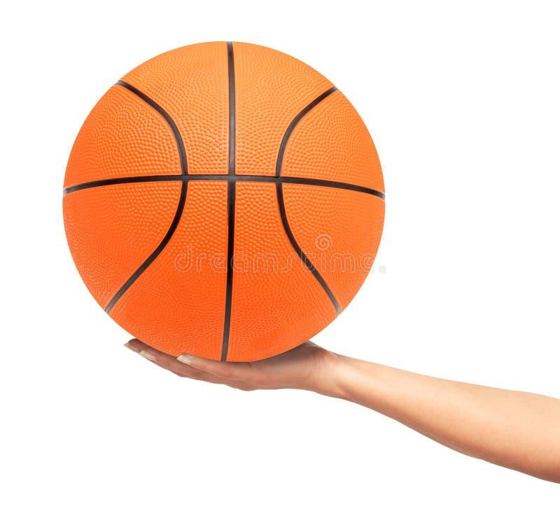 Koszykówki piłka na kobiety ręce odizolowywającej na bielu obraz stock