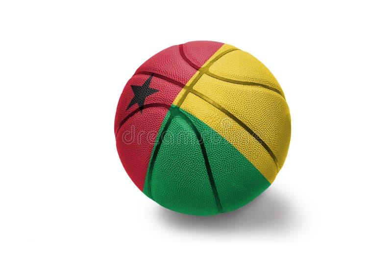 Koszykówki piłka z flagą państowową gwinea Bissau na białym tle zdjęcia stock