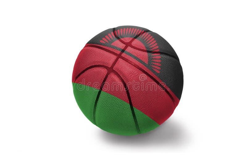 Koszykówki piłka z flagą państowową Malawi na białym tle zdjęcia royalty free