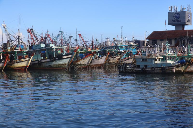 Fishing boats mooring at the waterfront of Kota Kinabalu in Sabah, Malaysia. Kota Kinabalu, Sabah/Malaysia - December 21 2019 - Fishing boats mooring at Sabah royalty free stock images