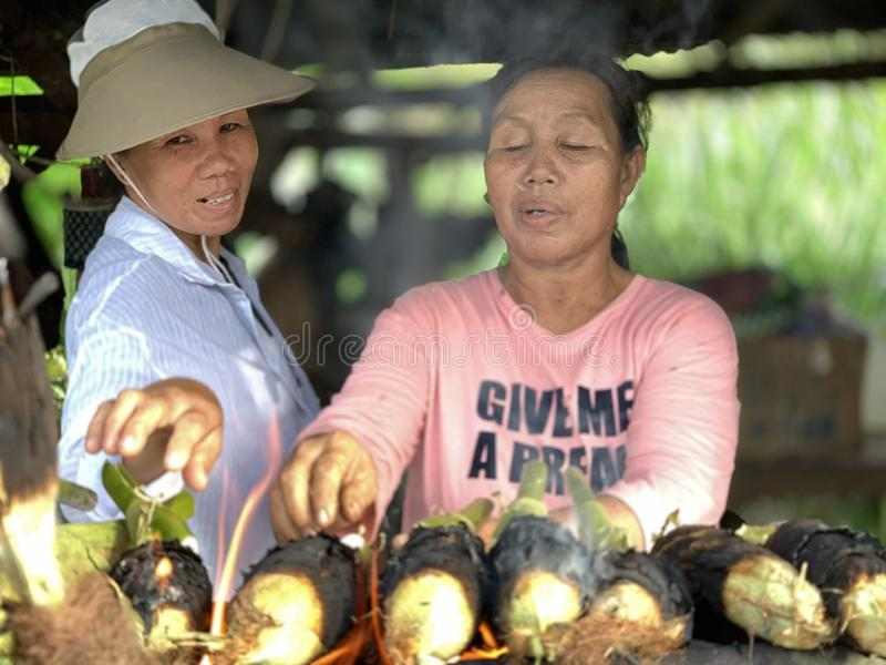 GrilledSweet Corn Kota Marudu. Kota Marudu,Sabah,Malaysia-June 6,2019:Undentified of people is burning sweet corn for sale to tourists who come to Kota Marudu royalty free stock images