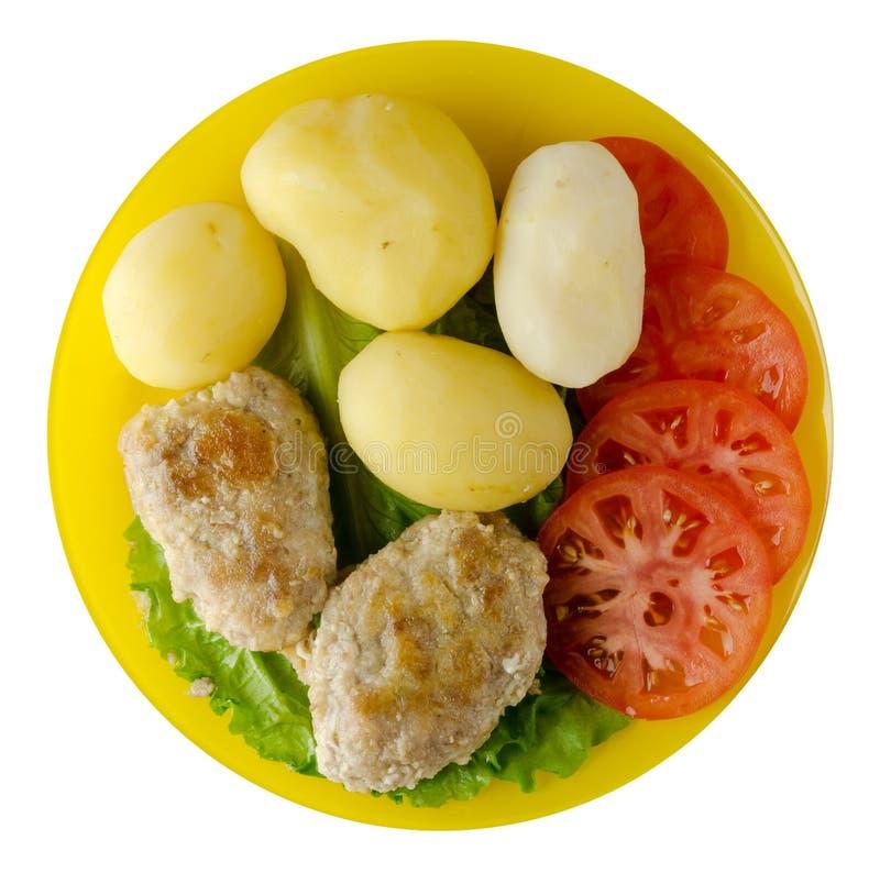 Kotelet met aardappels op een plaat royalty-vrije stock foto