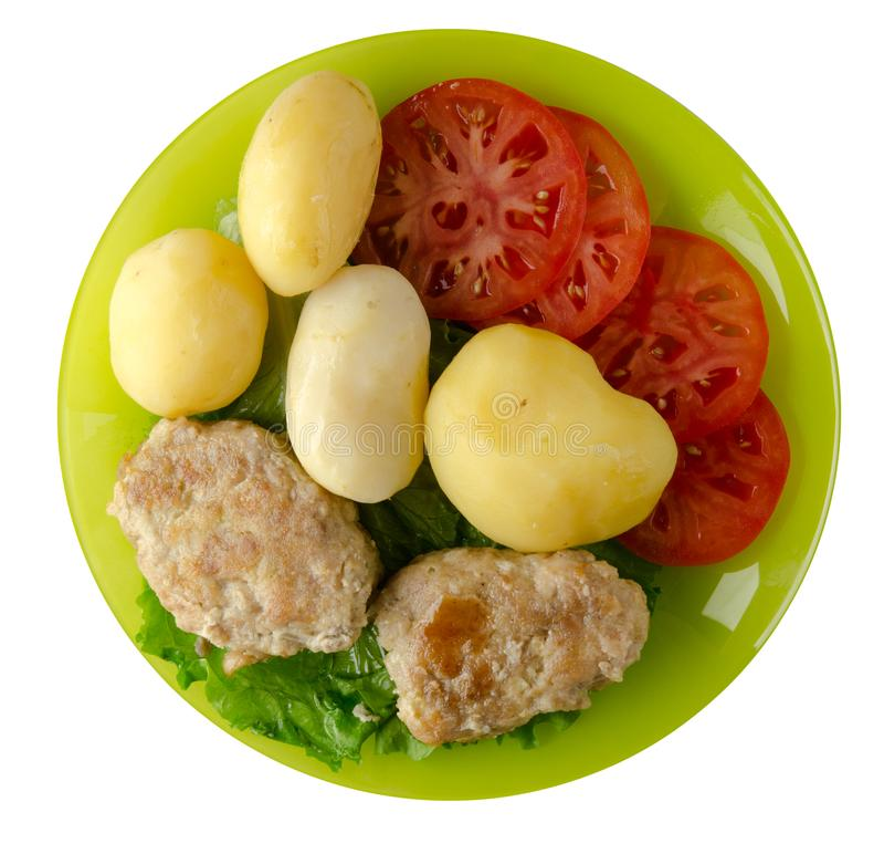 Kotelet met aardappels op een plaat stock foto