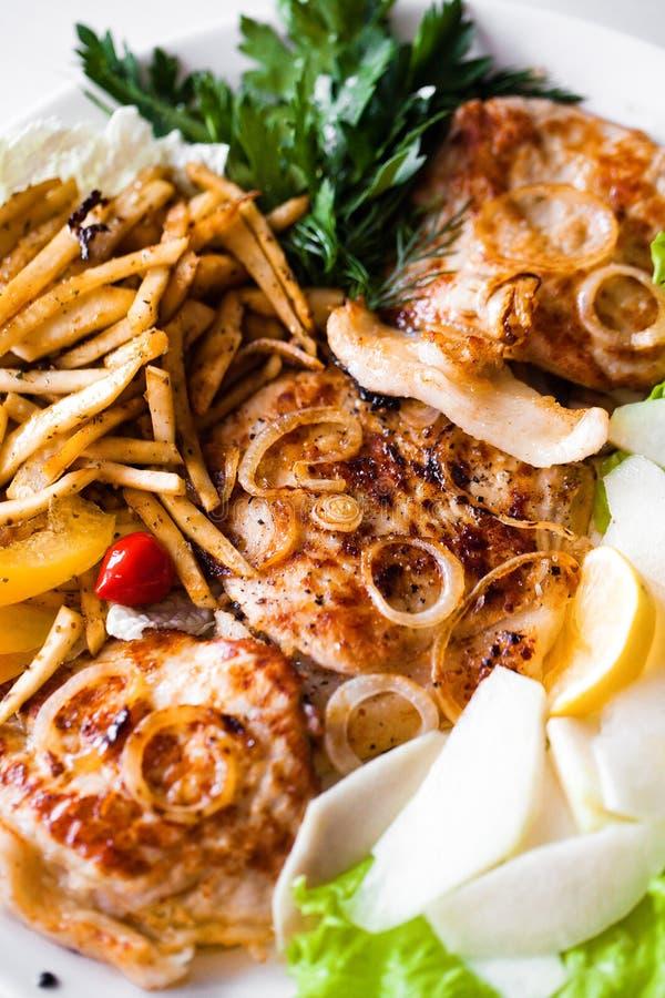 Kotelett und Fischrogen stockbild