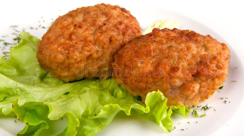Koteletten en salade stock fotografie