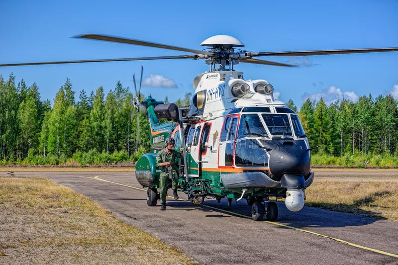 Airbus Helicopters H215 formerly Eurocopter AS332 Super Puma heavy-lift utility aircraft OH-HVP by Finland`s Border Guard parke. KOTKA, FINLAND - Aug 10, 2019 stock image
