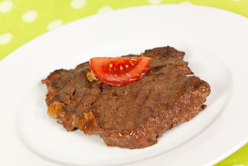 kotlettgallerpork grillade steak royaltyfria foton