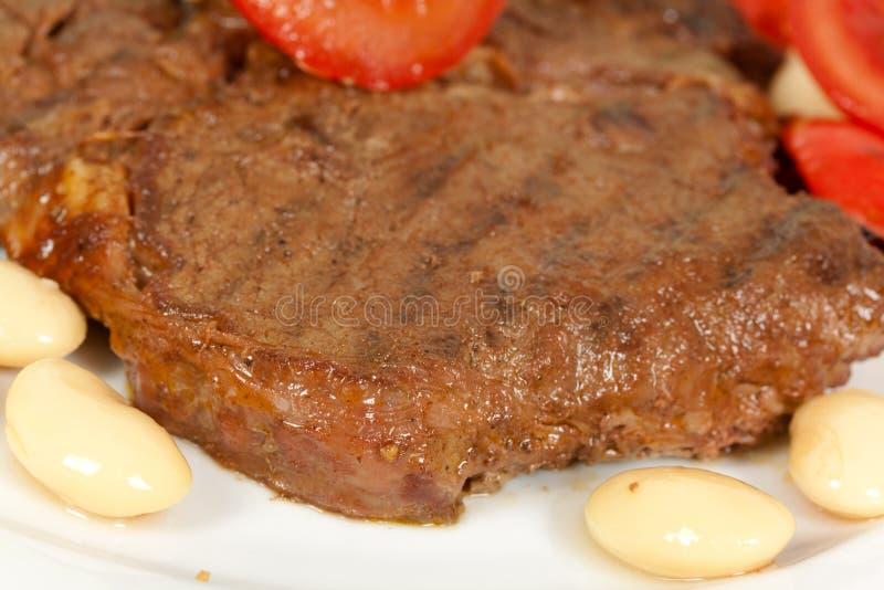 kotlettgallerpork grillade steak arkivbild