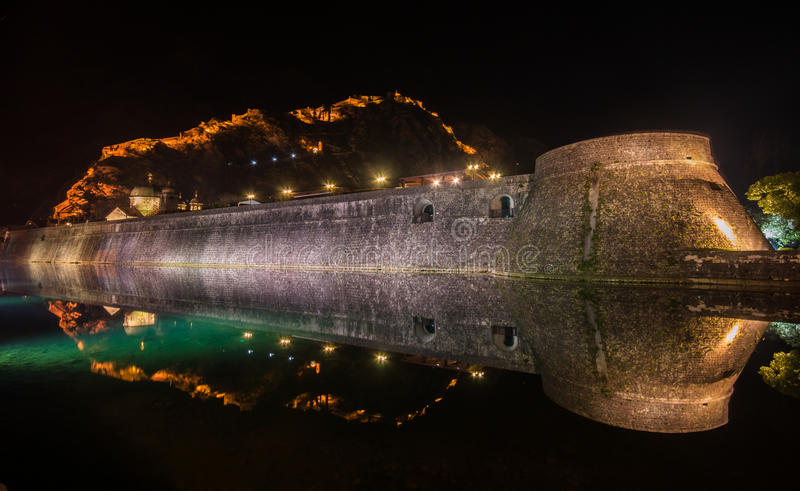 Kotor City Wall Fortifications, Montenegro. Kotor fortress wall and Old Town by night stock photos