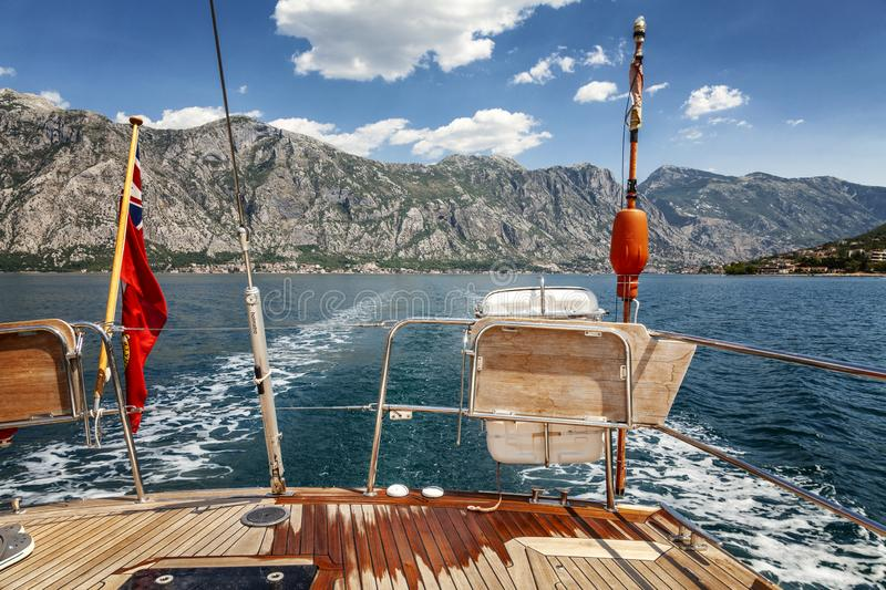 Kotor, Montenegro, 07/15/2015: Beautiful view from the stern of the yacht at the sea and magnificent nature royalty free stock photos