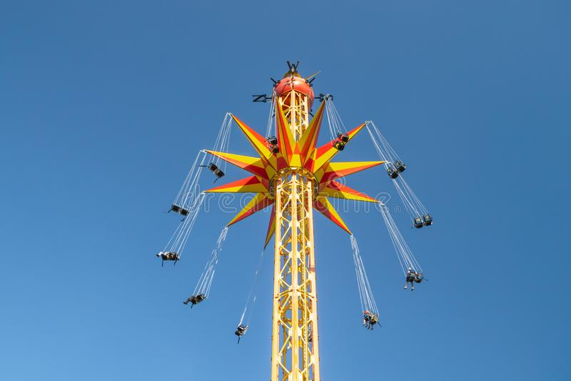 Kouvola, Finland - 18 May 2019: Ride Star Flyer in motion on sky background in amusement park Tykkimaki.  stock photography