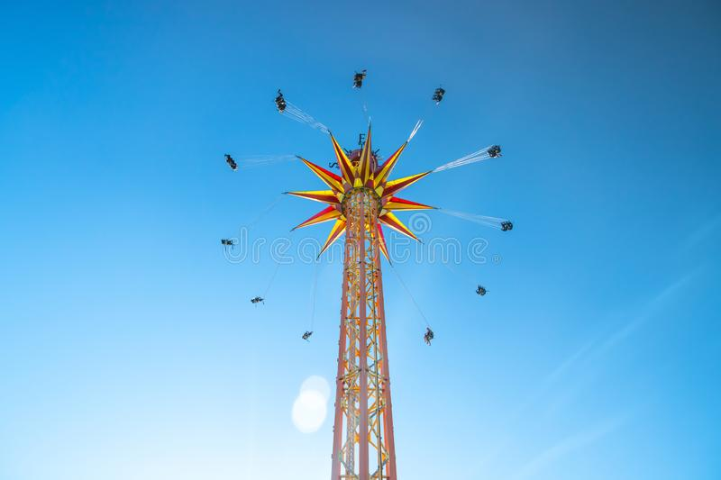 Kouvola, Finland - 18 May 2019: Ride Star Flyer in motion on sky background in amusement park Tykkimaki.  royalty free stock images